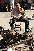 One man band busker musician, Abbey churchyard, Bath