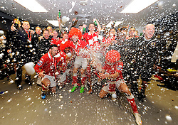 Bristol City players and back room staff celebrate in the changing room with champagne and the trophy  - Photo mandatory by-line: Joe Meredith/JMP - Mobile: 07966 386802 - 22/03/2015 - SPORT - Football - London - Wembley Stadium - Bristol City v Walsall - Johnstone Paint Trophy Final