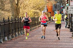 Boston Marathon: BAA 5K road race, runners warm up before race