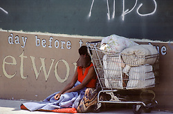 unusual homeless woman with a vail and shopping cart