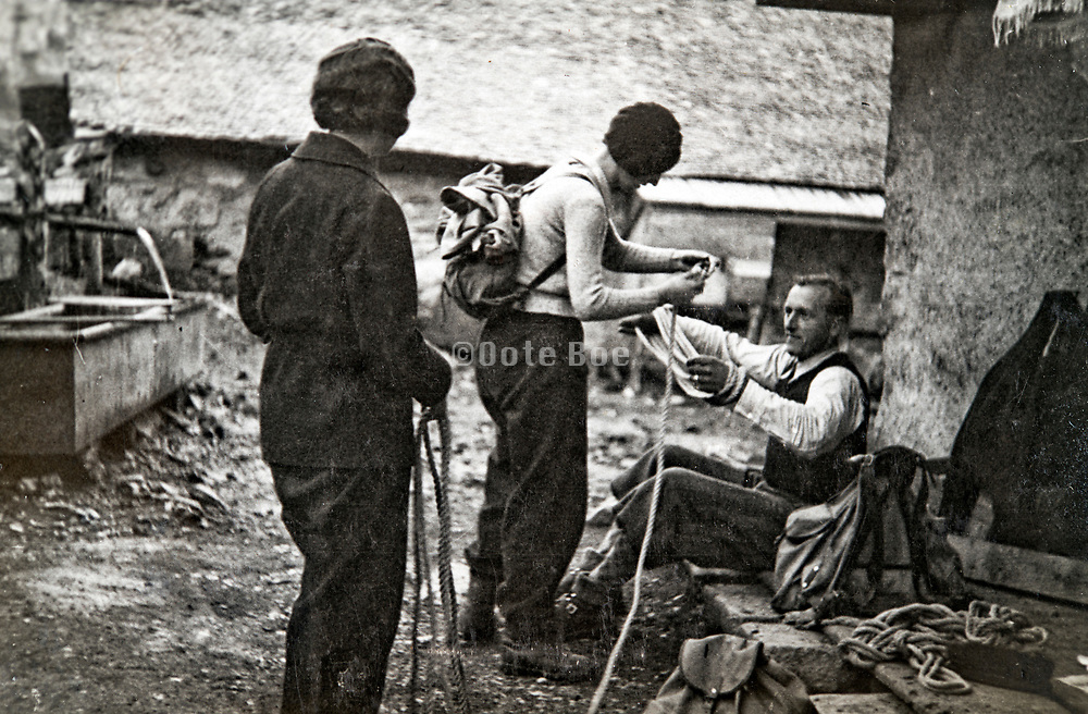 preparing ropes for a rock climbing expedition 1933 France