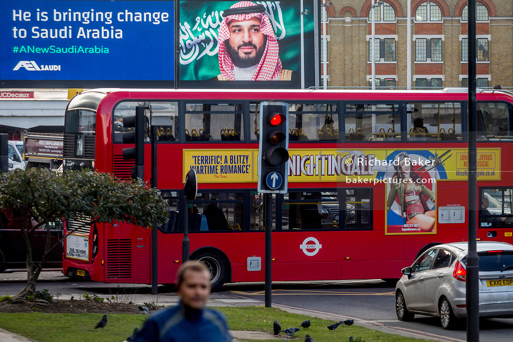 """On the first day of his official 3-day visit to London, the face of Saudi Crown Prince Mohammed bin Salman appears on a large billboard on West Cromwell Road, on 7th March 2018, in London England. Industry sources said the Saudis could be spending close to £1m on the city-wide campaign, which includes dozens of prime poster sites around London and newspaper ads. """"He is bringing change to Saudi Arabia,"""" the ads say, with a large photo of Crown Prince Mohammed bin Salman and the hashtag #ANewSaudiArabia."""