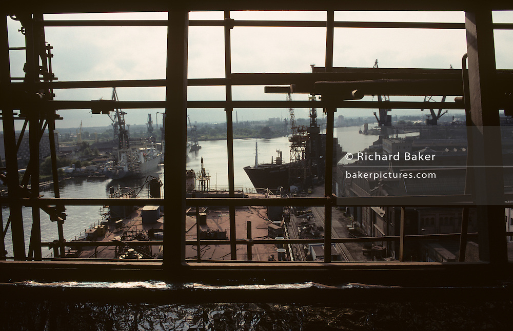 Aerial view through scaffolding of the of the Gdansk shipyard, from a high gantry overlooking ships, Gdansk, Poland.