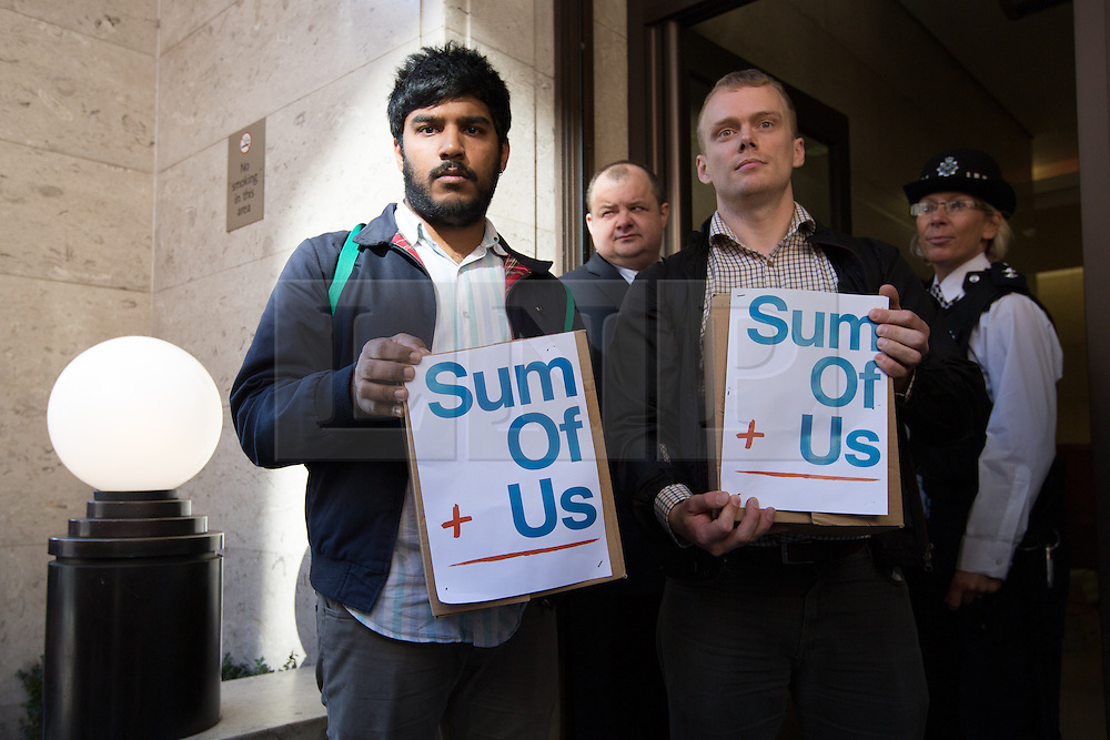 © licensed to London News Pictures. London, UK 06/10/2013. Members from the group 'Sum of Us' deliver a petition of 20,000 signatures to the Daily Mail newspaper head office in Kensington, London on 6 October 2013. Photo credit: Vickie Flores/LNP.