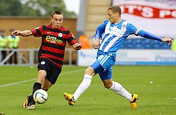 Peterborough United's Paul Taylor in action with Colchester United's Brain Wilson - Photo mandatory by-line: Joe Dent/JMP - Tel: Mobile: 07966 386802 26/10/2013 - SPORT - FOOTBALL - Colchester Community Stadium - Colchester - Colchester United v Peterborough United - Sky Bet League One