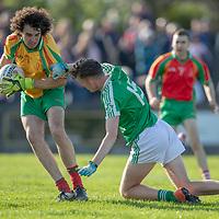 O'Curry's-Naomh Eoin's goalie Kieran Magner is tackled by Kilrush Shamrock's Stephen Ryan