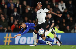 Derby County's Andre Wisdom (right) and Cardiff City's Anthony Pilkington battle for the ball