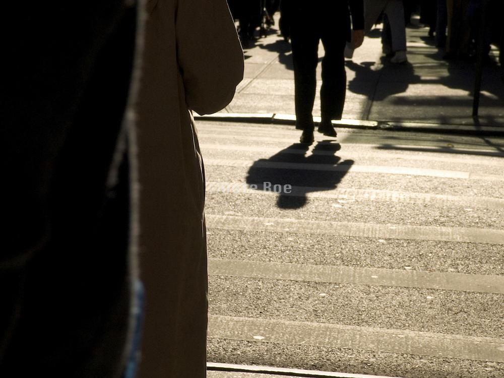 shadow of man walking alone street New York