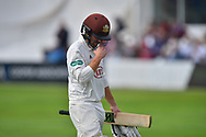Wicket - Rory Burns of Surrey looks dejected as he walks back to the pavilion after being dismissed by Tim Groenewald of Somerset during the opening day of the Specsavers County Champ Div 1 match between Somerset County Cricket Club and Surrey County Cricket Club at the Cooper Associates County Ground, Taunton, United Kingdom on 18 September 2018.