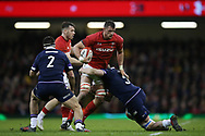 Aaron Shingler of Wales © runs in to Scotland's Stuart McInally (l) and Jonny Gray (5). Wales v Scotland, NatWest 6 nations 2018 championship match at the Principality Stadium in Cardiff , South Wales on Saturday 3rd February 2018.<br /> pic by Andrew Orchard, Andrew Orchard sports photography