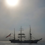 "CASCO BAY, Maine- 8/4/17 --  The 295-foot U.S. Coast Barque Eagle sailed into Portland Harbor on Friday morning in scattered clouds.  They opened for tours Saturday and Sunday.<br /> ""We are thrilled with the chance to host the crew and cadets of 'America's Tall ship,'"" said Capt. Michael Baroody, commander of Coast Guard Sector Northern New England. ""Portland has a strong maritime heritage.""<br /> Commanded by Capt. Matthew Meilstrup, the officers and permanent crew of Eagle train in seafaring using basics of wind power and traditional navigation.<br /> Cadets sail on Eagle for one to eight weeks, along with their instructors. Eagle recently toured Canada to celebrate the country's 150th anniversary. They sailed for New York City on Monday. Photo by Roger S. Duncan for the Forecaster"
