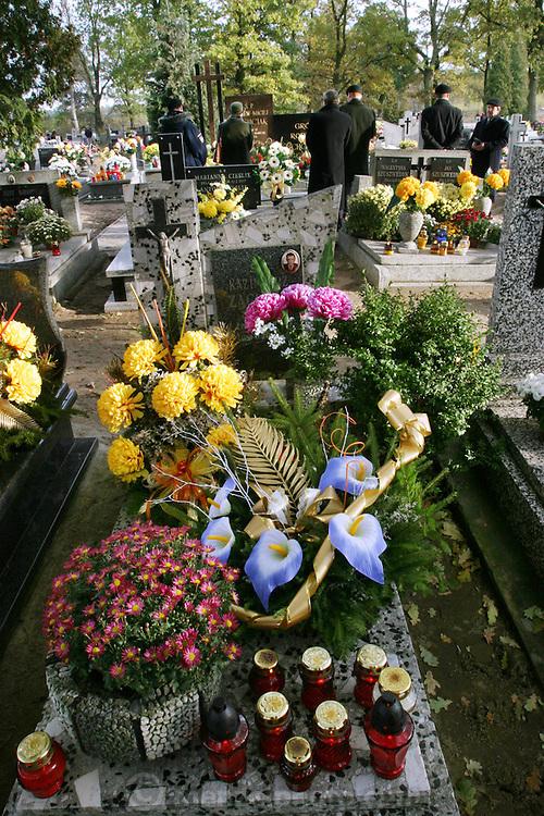 Wiezowski/Ledochowicz family. All Saints Day at cemetery in Lodz, Poland.