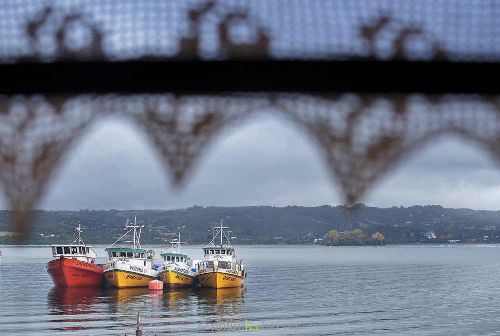 Fishing boats in harbor by Chiloe Island, Chile