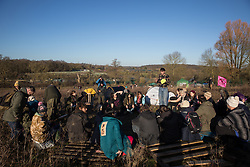 Harefield, UK. 19 January, 2020. Activists from Extinction Rebellion and Stop HS2 hold an assembly during a 'Stand for the Trees' event timed to coincide with tree felling work for the high-speed rail link on land from which bailiffs acting for HS2 had evicted Save the Colne Valley and Stop HS2 activists living in the Colne Valley wildlife protection camp almost two weeks previously. 108 ancient woodlands are set to be destroyed by the high-speed rail link.