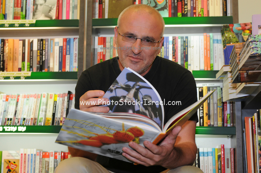 Erez Komarovsky an Israeli chef and artisan baker promotes his latest cookbook in a book store