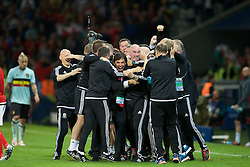5LILLE, FRANCE - Friday, July 1, 2016: Wales manager Chris Coleman is mobbed by his staff as they celebrate the 3-1 victory over Belgium at full time after the UEFA Euro 2016 Championship Quarter-Final match at the Stade Pierre Mauroy. (Pic by Paul Greenwood/Propaganda)