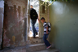 Iraqi refugees Ahmad Thamer, 13, and Hussein Thamer, 8, are seen on their way to the first day of school in Amman, Jordan, Aug. 19, 2007. Their family fled the violence in Baquba, Iraq two years ago and are waiting for asylum from the U.N. Refugee Agency so they can finally make a permanent home.