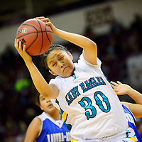 031114  Adron Gardner/Independent<br /> <br /> Navajo Prep Eagle Jazmine Benally (30) claims a rebound from the Laguna Acoma Hawks during the state high school basketball tournament at the Santa Ana Star Center in Rio Rancho.