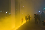 """Presentation of Olafur Eliasson's """"Yellow Fog"""" on the Facade of Verbund's """"Am Hof"""" Building in Vienna. From today, the center of Vienna acts as showcase for Verbund's permanent presentation of the artwork """"Yellow Fog"""" - Olafur Eliasson's first intervention in a public space in Vienna. Olafur Eliasson is one of the most renowned artists of modern times. His impressive work """"Yellow Fog"""" first shown in New York in 1988 can now be seen exclusively and permanently in Vienna. The site of the interventions are the Verbund building and the historic """"Am Hof"""" square, which will be transformed daily into a public stage for a show of light and fog during the hours of dusk..Embedded in the pavement along the front of Verbund's headquarters is a framework containing 32 luminescent tubes, providing a broad, uniform light. After the fall of dusk, fog rises for approximately 40 seconds in a yellow light upwards to the height of the facade. In intervals of approximately three minutes, the process is repeated and envelops the building in a momentary fog over the course of one hour."""