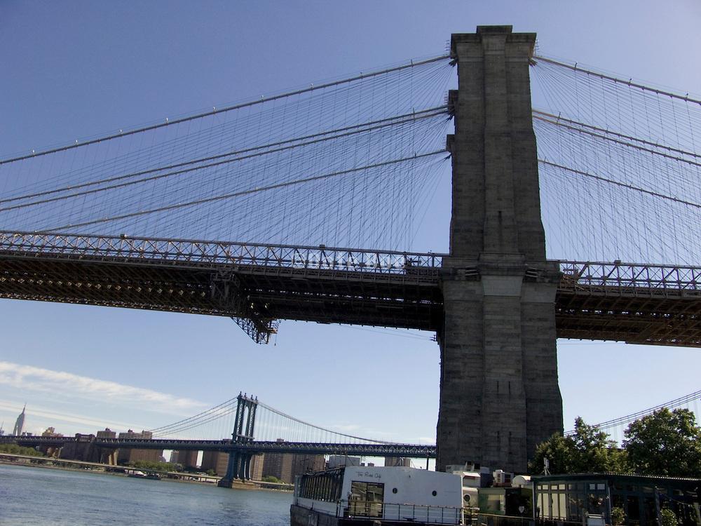 pillar of the Brooklyn bridge with the Manhattan bridge in the background