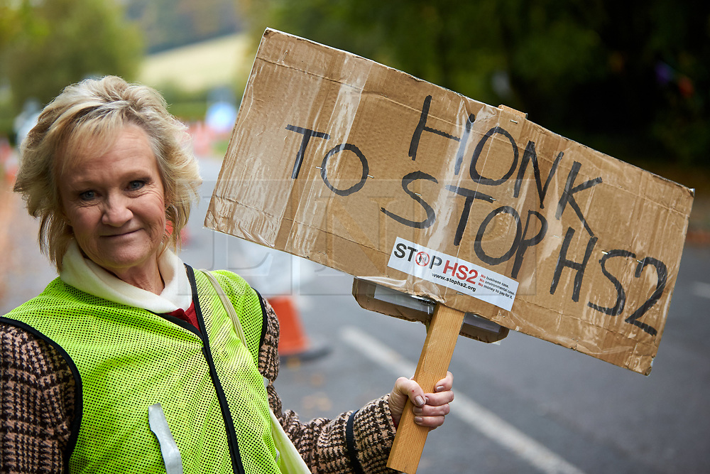 © Licensed to London News Pictures. 23/10/2019. GREAT MISSENDEN, UK.  Enabling works to allow the construction of the HS2 railway continue despite the future of the project being reviewed. A number of mature trees were due to be felled last week to allow easier access for construction traffic but local residents and climate activists created a makeshift camp to prevent their destruction.. In this picture: ANN HAYWARD, who lives in nearby Wendover which will be heavily impacted by HS2, at the protest site. Photo credit: Cliff Hide/LNP