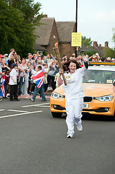 The Olympic Torch relay reaches Sheffield on day 38 coverage from the Chapeltown - Ecclesfield - Parson Cross section of the Journey.<br /> Torch Bearer 112  Ashley Jeeves aged 14<br /> 25 June 2012.<br /> Image © Paul David Drabble