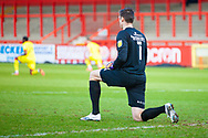Kneeling in respect during the EFL Sky Bet League 2 match between Stevenage and Walsall at the Lamex Stadium, Stevenage, England on 20 February 2021.