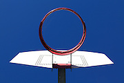 underneath a basketball hoop without net