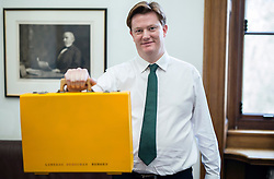 HANDOUT PICTURE: © Licensed to London News Pictures.18/03/2015 London, UK. Chief Secretary to the Treasury, Danny Alexander MP poses with a yellow budget box in his office in the Treasury. Today Chancellor George Osbourne announces the last budget before the general election.  Photo by James Gourley/Liberal Democrats/LNP