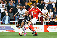 Port Vale's Byron Moore and Crewe Alexandre's Jon Guthrie battle for the ball. Skybet football league one match, Crewe Alexandra v Port Vale at the Alexandra Stadium in Crewe on Saturday 13th Sept 2014.<br /> pic by Chris Stading, Andrew Orchard sports photography.