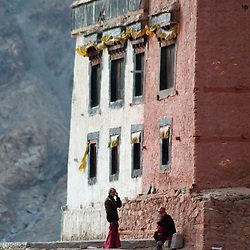Young Buddhist Monks hand out in front of the mountain top temple above Leh.