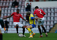 Football - 2020 / 2021 Emirates FA Cup - Round Two: Morecambe vs. Solihull Moors<br /> <br /> James Ball of Solihull Moors holds off the challenges of Yann Songo'o and Kelvin Mellor of Morecambe, at the Mazuma Stadium.<br /> <br /> COLORSPORT/ALAN MARTIN