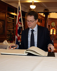 © Licenced to London News Pictures. 09/12/2013. London. UK.  <br /> Deputy Prime Minister Nick Clegg is pictured signing the Nelson Mandela condolence book at the South African High Commission at South Africa House in London, December 9th 2013. <br /> Photo Credit: Susannah Ireland