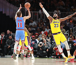 February 12, 2019 - Atlanta, GA, USA - Atlanta Hawks guard Trae Young shoots over Los Angeles Lakers LeBron James during the second half in a 117-113 victory on Tuesday, Feb. 12, 2019 in Atlanta, Ga. (Credit Image: © Curtis Compton/Atlanta Journal-Constitution/TNS via ZUMA Wire)