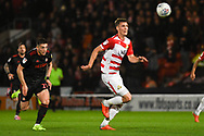 Joe Wright of Doncaster Rovers (5) looks to clear the ball under pressure from Lynden Gooch of Sunderland (11) during the EFL Sky Bet League 1 match between Doncaster Rovers and Sunderland at the Keepmoat Stadium, Doncaster, England on 23 October 2018.