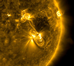 July 19, 2017 - Space - On July 14th a medium-sized (M2) solar flare and a coronal mass ejection (CME) erupted from the same, large active region of the sun on July 14, 2017. The flare lasted almost two hours, quite a long duration. The coils arcing over this active region are particles spiraling along magnetic field lines, which were reorganizing themselves after the magnetic field was disrupted by the blast. Images were taken in a wavelength of extreme ultraviolet light. (Credit Image: © NASA/GSFC/Solar Dynamics/ZUMA Wire/ZUMAPRESS.com)