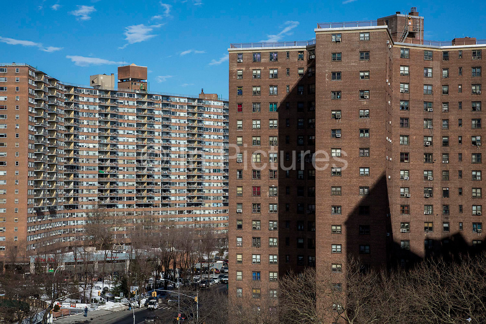 The red brick apartment blocks of The Governor Alfred E. Smith Houses, a public housing development built by the New York City Housing Authority in the Two Bridges neighbourhood of the Lower East Side of Manhattan.  There are 12 buildings in this complex, each 17 stories tall and houses approximately 5,739 people.
