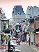 Horse and carriage tours on famous Bourbon Street are a popular way for tourists to enjoy the architecture and ambience of New Orleans historic French Quarter.