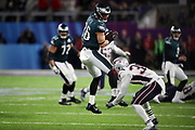 Philadelphia Eagles tight end Zach Ertz (86) gets upended by New England Patriots strong safety Duron Harmon (30) as he jumps and catches a pass for a gain of 2 yards and a key first down at the Eagles 47 yard line on a late fourth quarter scoring drive during the 2018 NFL Super Bowl LII football game against the New England Patriots on Sunday, Feb. 4, 2018 in Minneapolis. The Eagles won the game 41-33. (©Paul Anthony Spinelli)