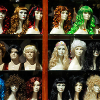 Europe, Ireland, Dublin. WIgs on display in shop window.