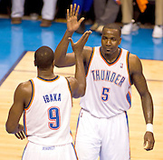 June 2, 2012; Oklahoma City, OK, USA; Oklahoma City Thunder forward Serge Ibaka (9) and center Kendrick Perkins (5) react during the first half of a playoff game against the San Antonio Spurs at Chesapeake Energy Arena.  Mandatory Credit: Beth Hall-US PRESSWIRE