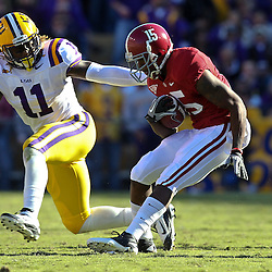 November 6, 2010; Baton Rouge, LA, USA; Alabama Crimson Tide wide receiver Darius Hanks (15) catches a pass in front of LSU Tigers linebacker Kelvin Sheppard (11) during the first half at Tiger Stadium.  Mandatory Credit: Derick E. Hingle