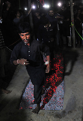 October 28, 2016 - Allahabad, Uttar Pradesh, India - Allahabad: Shia Muslim devotee walks on cinder/anagar as they take part in a mourning procession during Muharram in Allahabad on 28-10-2016, Muharram is celebrated to mark the climax of the mourning which is Called Ashura, The ccommenmoration of Imam Hussain's. photo by prabhat kumar verma (Credit Image: © Prabhat Kumar Verma via ZUMA Wire)