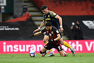 Dominic Solanke (9) of AFC Bournemouth is fouled by Danny Batth (6) of Stoke City during the EFL Sky Bet Championship match between Bournemouth and Stoke City at the Vitality Stadium, Bournemouth, England on 8 May 2021.