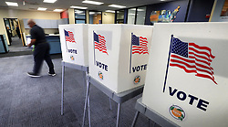 March 17, 2020, Orlando, Florida, USA: A voter casts his ballot at the Orange County Supervisor of Elections office in Orlando, in the Florida primary. Democratic voters are making their choice for their party's nominee in the 2020 presidential election. Florida Secretary of State Laurel Lee rejected all requests to provide flexibility in primary-day voting, refusing to extend the vote-by-mail ballot deadlines despite guidance from public health officials that people stay away from group gatherings to avoid the spread of the coronavirus. (Credit Image: © TNS via ZUMA Wire)