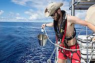 North Atlantic Ocean, October 2014.<br /> North Atlantic Ocean, October 2014.<br /> Marine biologist Adam Porter collects sea water for his plankton samples, on board the Sea Dragon.  © Chiara Marina Grioni