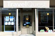 Travel Quest travel agent shop window in Woodbridge, Suffolk, England, UK