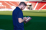 Wimbledon midfielder Scott Wagstaff (7) looks at the match day programme during the EFL Sky Bet League 1 match between Doncaster Rovers and AFC Wimbledon at the Keepmoat Stadium, Doncaster, England on 17 November 2018.