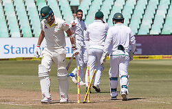Durban. 020318. Patrick Cummins of Aystralia is bowled by Keshav Maharaj of South Africa during the Sunfoil Test match played at Kingsmead, Durban. Picture Leon Lestrade/African News Agancy/ANA.
