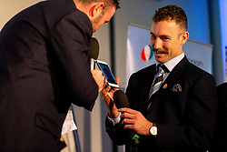 Mark Stevens talks with Nic White and Jack Nowell to Henry Slade on the phone at the annual Exeter Chiefs Foundation Christmas Dinner at Sandy Park - Ryan Hiscott/JMP - 07/12/2018 - RUGBY - Sandy Park - Exeter, England - Exeter Chiefs Foundation Christmas Dinner with David Flatman